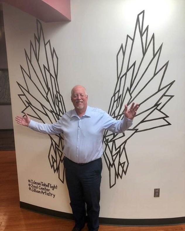 Dan Oakland by the angel wing mural