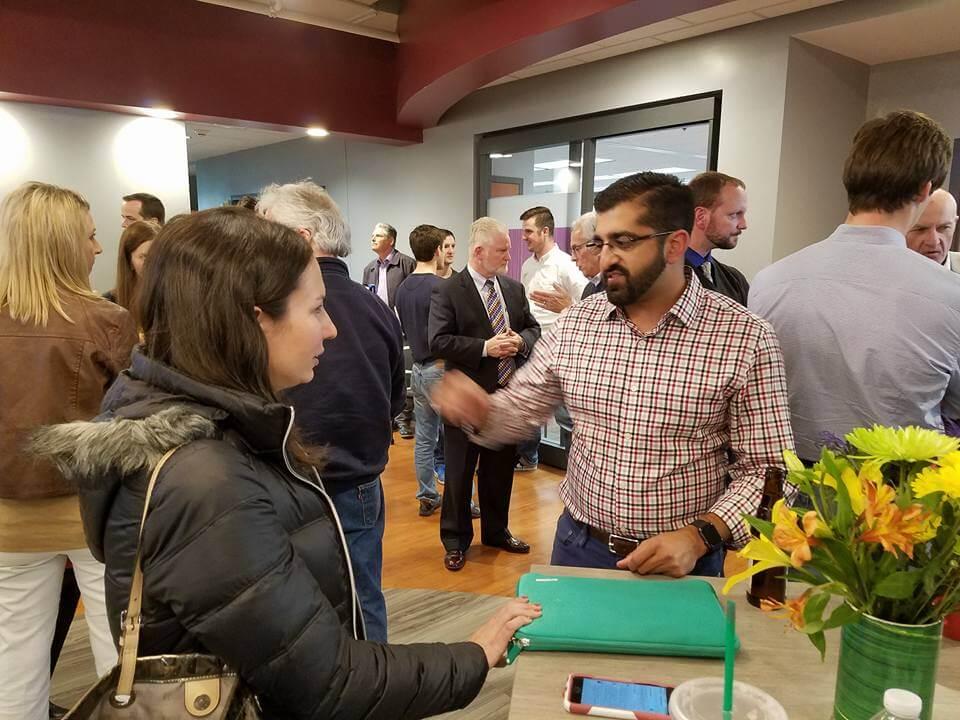 Paul Singh and Jodi Schwan talking at entrepreneurial event